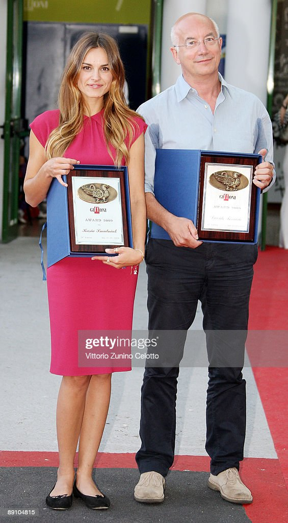 Actress Kasia Smutniak (L) and Davide Ferrario (R) pose with the Giffoni Award during the 2009 Giffoni Experience on July 19, 2009 in Salerno, Italy.