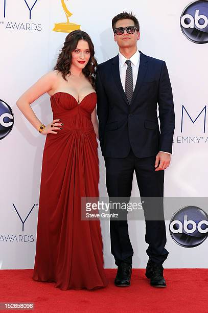 Actress Kat Dennings and guest arrive at the 64th Primetime Emmy Awards at Nokia Theatre L.A. Live on September 23, 2012 in Los Angeles, California.