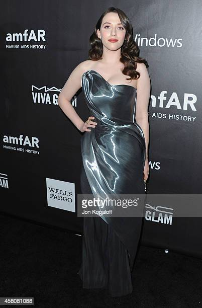Actress Kat Dennings arrives at the 2014 amfAR LA Inspiration Gala at Milk Studios on October 29 2014 in Hollywood California