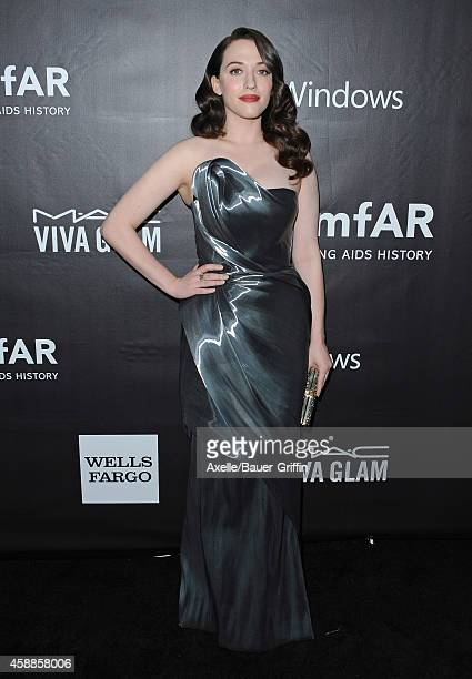 Actress Kat Dennings arrives at the 2014 amfAR LA Inspiration Gala at Milk Studios on October 29 2014 in Hollywood California