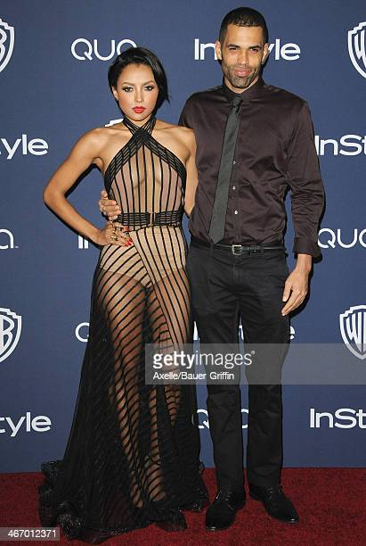 Actress Kat Graham and Cottrell Guidry arrive at the 2014 InStyle And Warner Bros 71st Annual Golden Globe Awards PostParty at The Beverly Hilton...