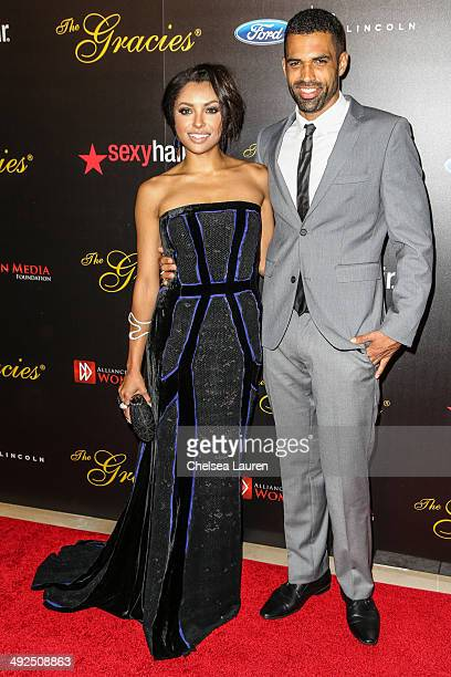 Actress Kat Graham and Cottrell Guidry arrive at the 39th annual Gracie Awards at The Beverly Hilton Hotel on May 20 2014 in Beverly Hills California
