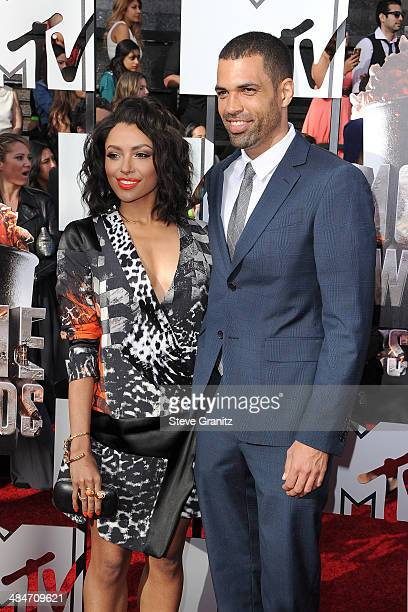 Actress Kat Graham and Cottrell Guidry attend the 2014 MTV Movie Awards at Nokia Theatre LA Live on April 13 2014 in Los Angeles California