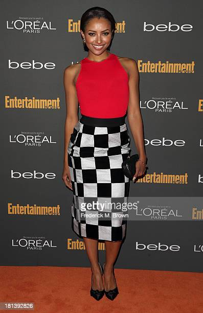 Actress Kat Graham arrives at Entertainment Weekly's Pre-Emmy Party at Fig & Olive Melrose Place on September 20, 2013 in West Hollywood, California.