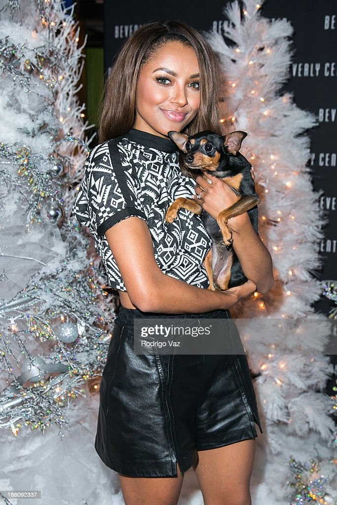 Actress Kat Graham attends as The Beverly Center kicks off 'Holiday Pet Portraits With Santa!' at The Beverly Center on November 14, 2013 in Los Angeles, California.