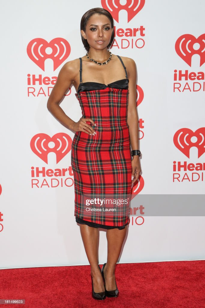 Actress Kat Graham poses in the iHeartRadio music festival photo room on September 21, 2013 in Las Vegas, Nevada.