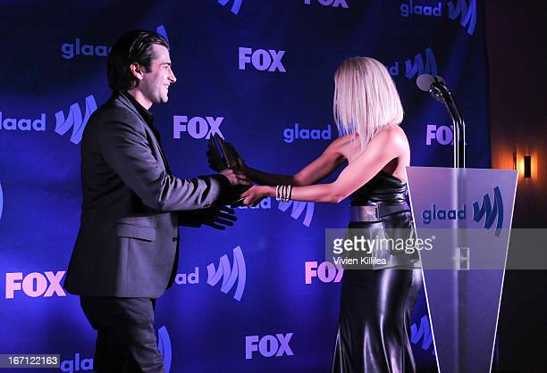 Actress Kat Graham presents the GLAAD Media Award for Outstanding Daily Drama to Freddie Smith from Days of Our Lives at the 24th Annual GLAAD Media...