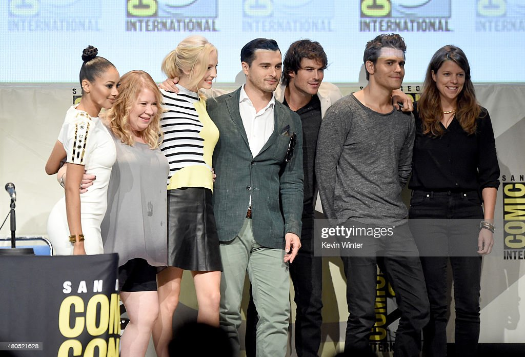 Actress Kat Graham, producer Julie Plec, actress Candice Accola, actor Michael Malarkey, actor Ian Somerhalder, actor Paul Wesley and producer Caroline Dries attend the 'The Vampire Diaries' panel during Comic-Con International 2015 at the San Diego Convention Center on July 12, 2015 in San Diego, California.