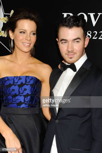 Actress Kate Beckinsale and musician Kevin Jonas arrive at the Hollywood Domino's 7th Annual PreOscar Charity Gala at Sunset Tower on February 27...
