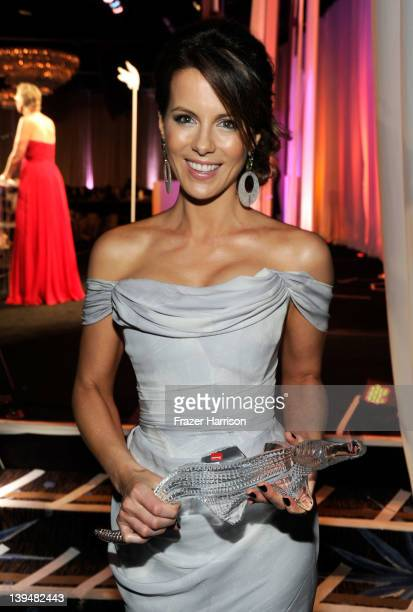 Actress Kate Beckinsale poses with the Lacoste Spolight Award during the 14th Annual Costume Designers Guild Awards With Presenting Sponsor Lacoste...