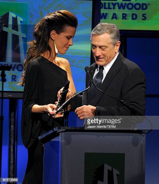 Actress Kate Beckinsale presents the Actor of the Year award to Robert De Niro onstage during the 13th annual Hollywood Awards Gala Ceremony held at...