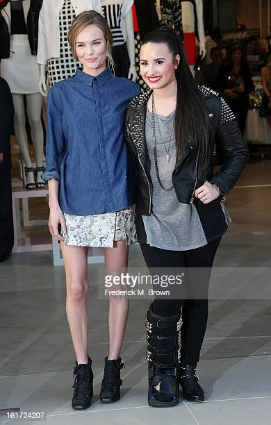 Actress Kate Bosworth and recording artist Demi Lovato attend the Topshop Topman LA Grand Opening at The Grove on February 14 2013 in Los Angeles...