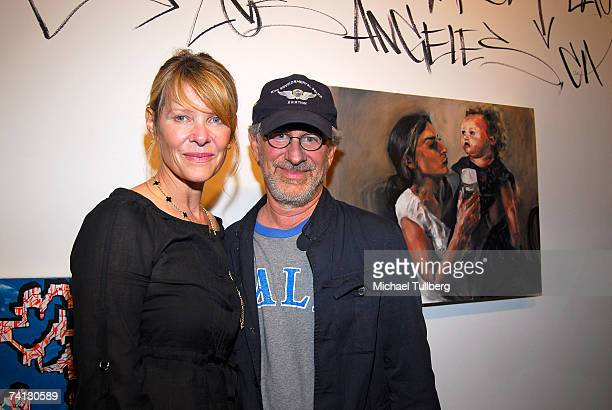 Actress Kate Capshaw and director Steven Spielberg pose by their daughter Sasha's painting at the ARTribe Art Show in support of the SPIRAL...