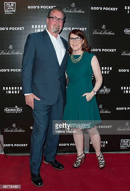 Actress Kate Flannery and photographer Chris Haston arrive at the Premiere Of IFC Films' God's Pocket at LACMA on May 1 2014 in Los Angeles California