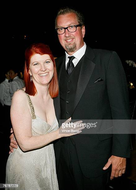 Actress Kate Flannery and photographer Chris Haston pose at the Governor's Ball after the 59th Annual Primetime Emmy Awards at the Shrine Auditorium...