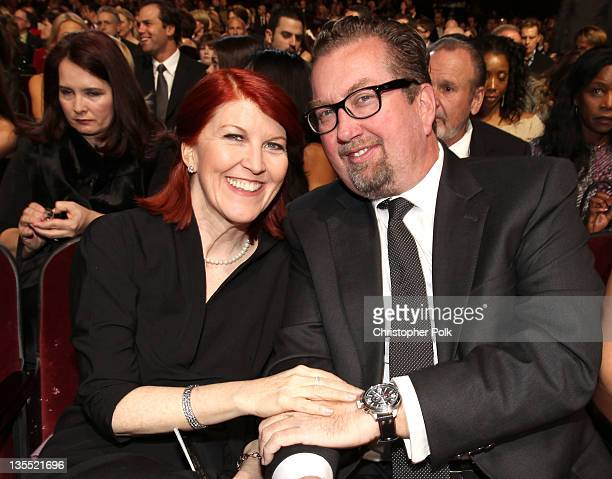 Actress Kate Flannery and photographer Chris Haston pose in the audience during the 2011 CNN Heroes An AllStar Tribute at The Shrine Auditorium on...