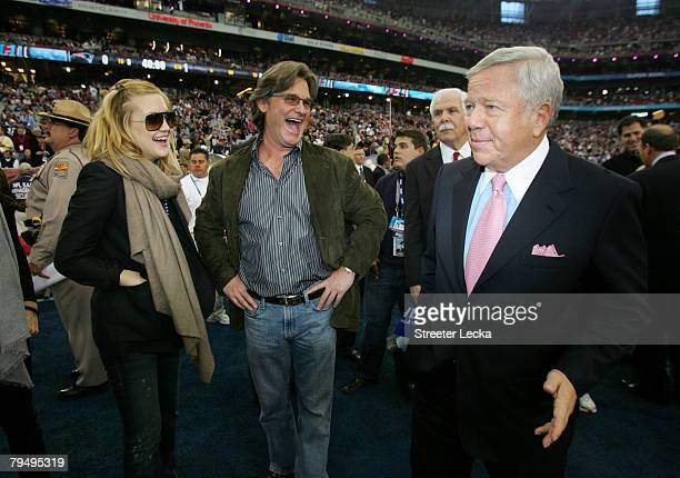 Actress Kate Hudson, actor Kurt Russell and Owner Robert Kraft of the New England Patriots talk before Super Bowl XLII between the New York Giants...