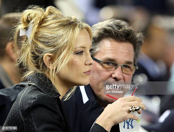 Actress Kate Hudson and actor Kurt Russell watch as the New York Yankees take on the Minnesota Twins in Game Two of the ALDS during the 2009 MLB...