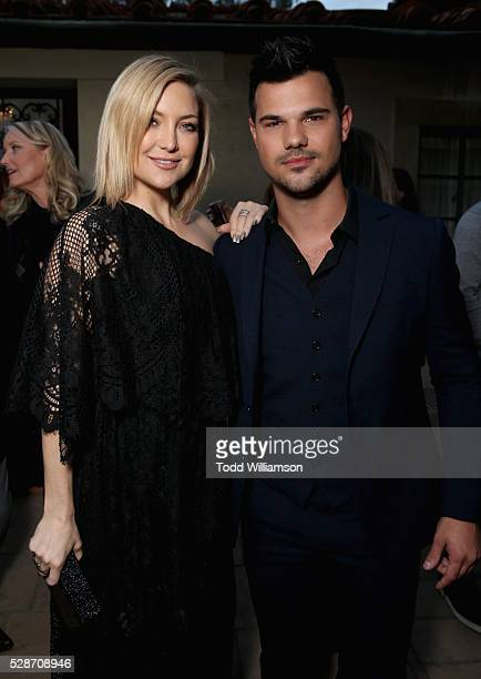 Actress Kate Hudson and actor Taylor Lautner attend Annual Goldie's Love In For Kids hosted by Goldie Hawn at Ron Burkle's Green Acres Estate on May...