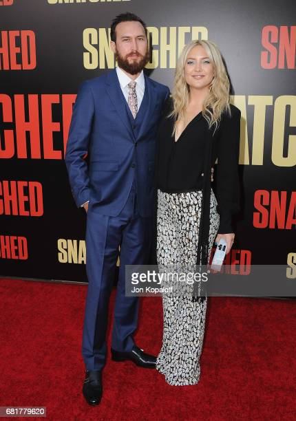 "Actress Kate Hudson and boyfriend Danny Fujikawa arrive at the Los Angeles Premiere ""Snatched"" at Regency Village Theatre on May 10, 2017 in..."