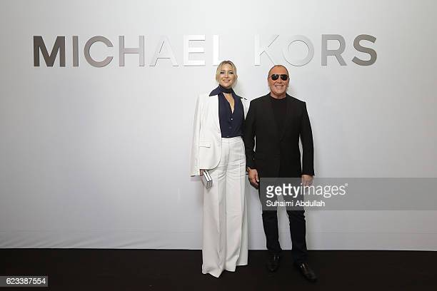 Actress Kate Hudson and designer Michael Kors attend the Michael Kors Mandarin Gallery Flagship Store Opening Cocktail Party at Orchard Road on...