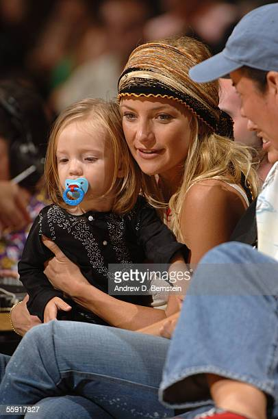 Actress Kate Hudson and her son Ryder Russell Robinson enjoy a preseason game between the Los Angeles Lakers and the Golden State Warriors October...