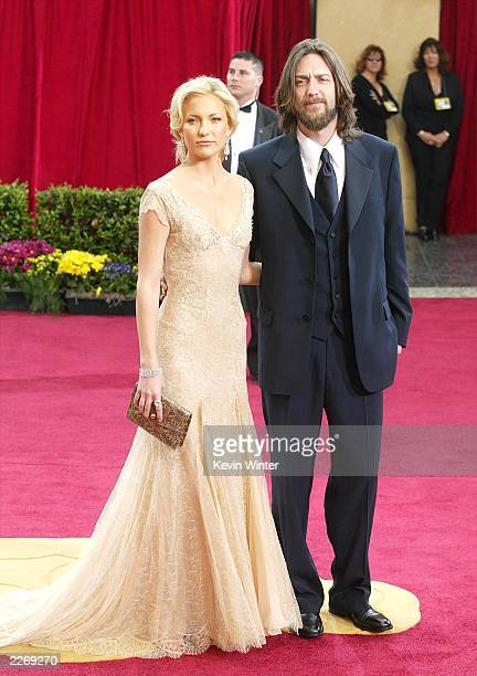 Actress Kate Hudson and husband Chris Robinson attend the 75th Annual Academy Awards at the Kodak Theater on March 23 2003 in Hollywood California