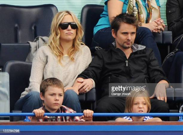 Actress Kate Hudson and Muse lead singer Matthew Bellamy with Hudson's son Ryder Russell Robinson watch during the Barclays Premier League match...