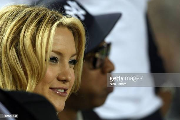 Actress Kate Hudson and rapper JayZ look on from the stands before Game One of the ALDS between the Minnesota Twins and the New York Yankees during...