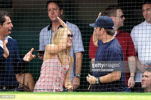 Actress Kate Hudson celebrates after Alex Rodriguez of the New York Yankees hits a home run during the forth inning in Game Three of the ALCS against...