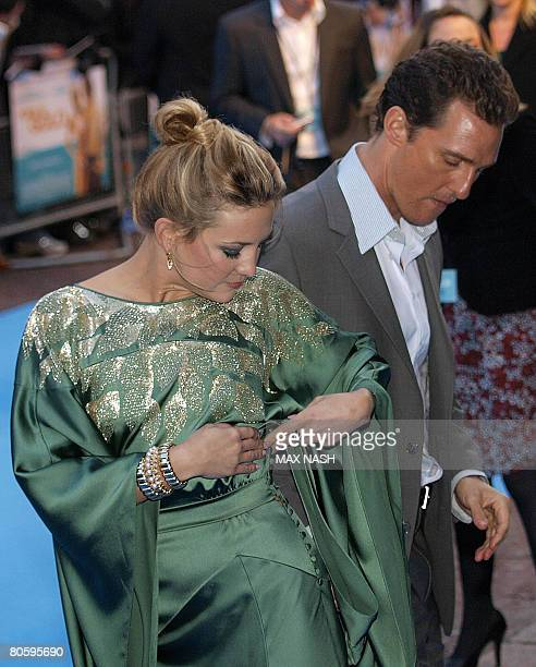 US actress Kate Hudson looks at her dress as costar Matthew McConaughey looks down as they arrives for the European Premiere of her latest film...