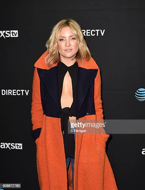 Actress Kate Hudson poses wearing a orange and blue coat in support of the Denver Broncos at DirecTV Super Saturday Night at Pier 70 on February 6...