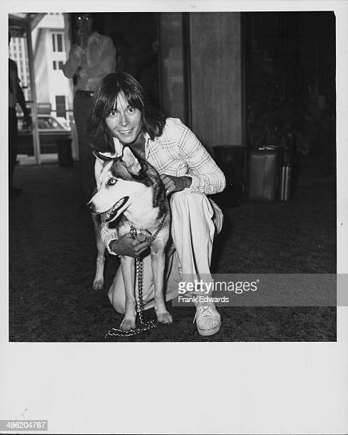 Actress Kate Jackson posing with her Siberian husky Catcher attending the ABC Television reception July 1976