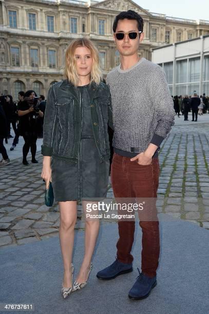 Actress Kate Mara and boyfriend Max Minghella arrive at the Louis Vuitton show as part of the Paris Fashion Week Womenswear Fall/Winter 20142015 on...
