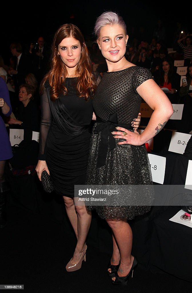 Actress Kate Mara and Kelly Osbourne attend the Badgley Mischka Fall 2012 fashion show during Mercedes-Benz Fashion Week at The Theatre at Lincoln Center on February 14, 2012 in New York City.