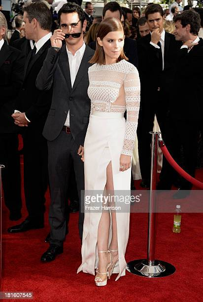 Actress Kate Mara and Max Minghella arrive at the 65th Annual Primetime Emmy Awards held at Nokia Theatre LA Live on September 22 2013 in Los Angeles...