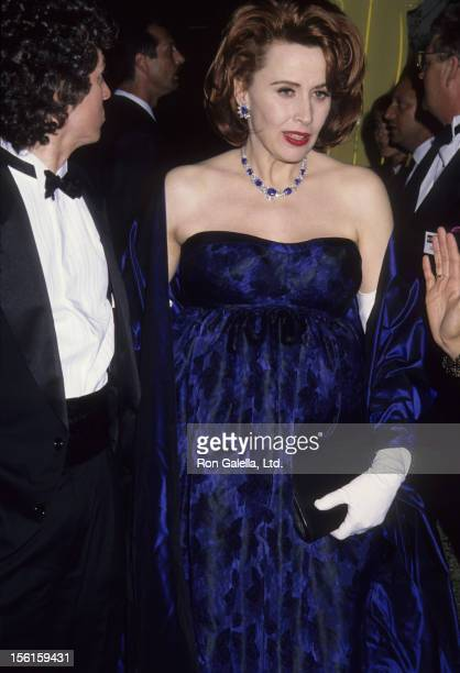 Actress Kate Nelligan and husband Robert Reale attend Swifty Lazar Oscar Party on March 30 1992 at Spago Restaurant in West Hollywood California