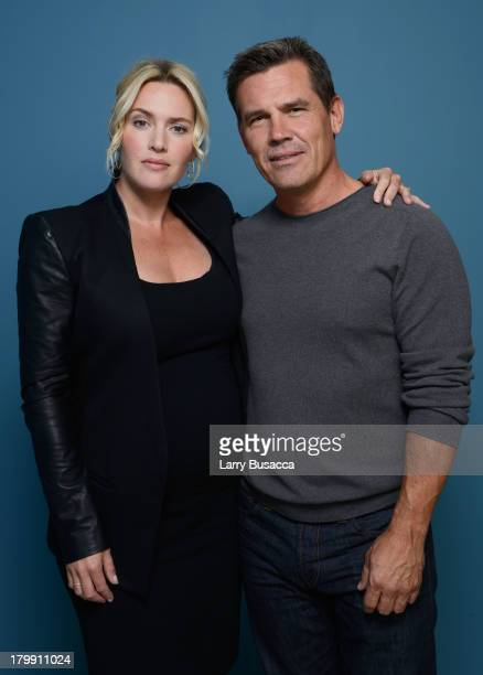 Actress Kate Winslet and actor Josh Brolin of 'Labor Day' pose at the Guess Portrait Studio during 2013 Toronto International Film Festival on...