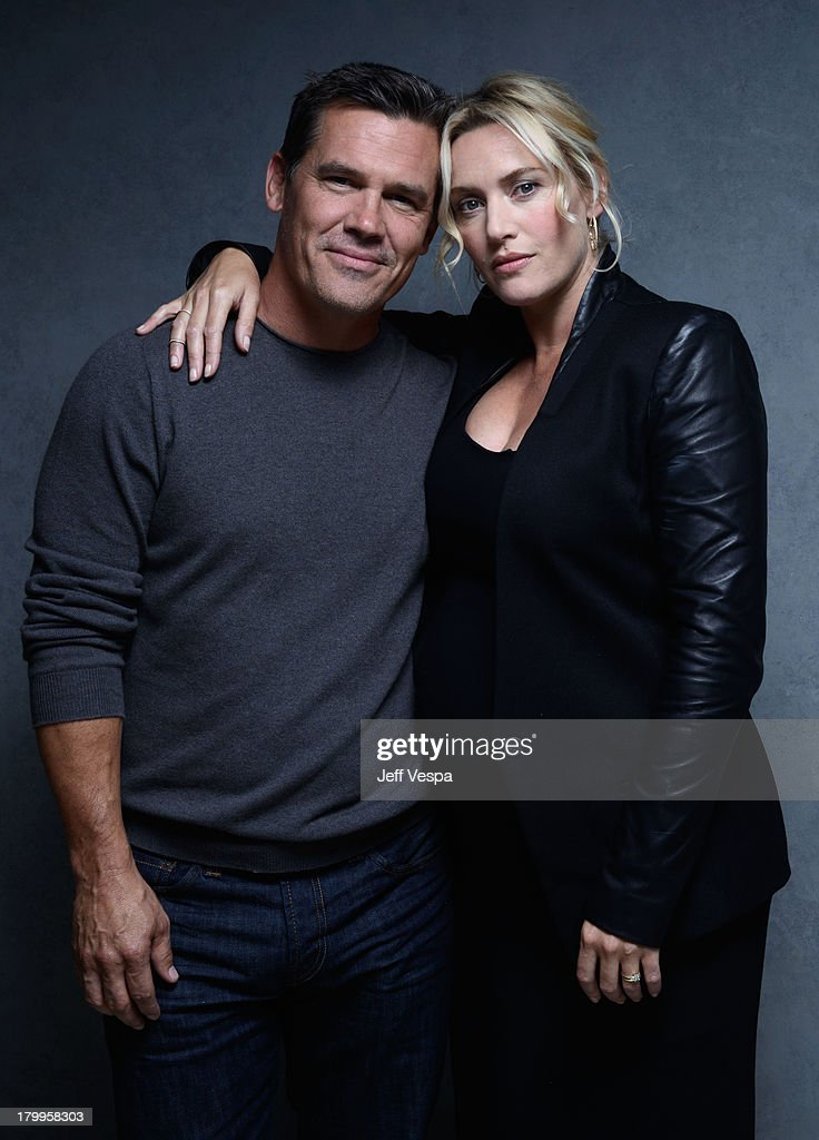 Actress Kate Winslet and actor Josh Brolin of 'Labor Day' pose at the Guess Portrait Studio during 2013 Toronto International Film Festival on September 7, 2013 in Toronto, Canada.
