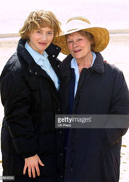 Actress Kate Winslet and Dame Judi Dench on the set of the movie 'Iris' In Suffolk Great Britain
