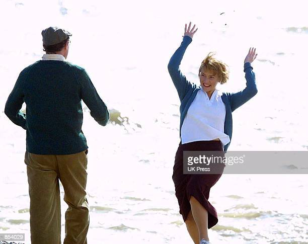 Actress Kate Winslet and Hugh Bonneville act in a scene from the movie 'Iris' In Suffolk Great Britain