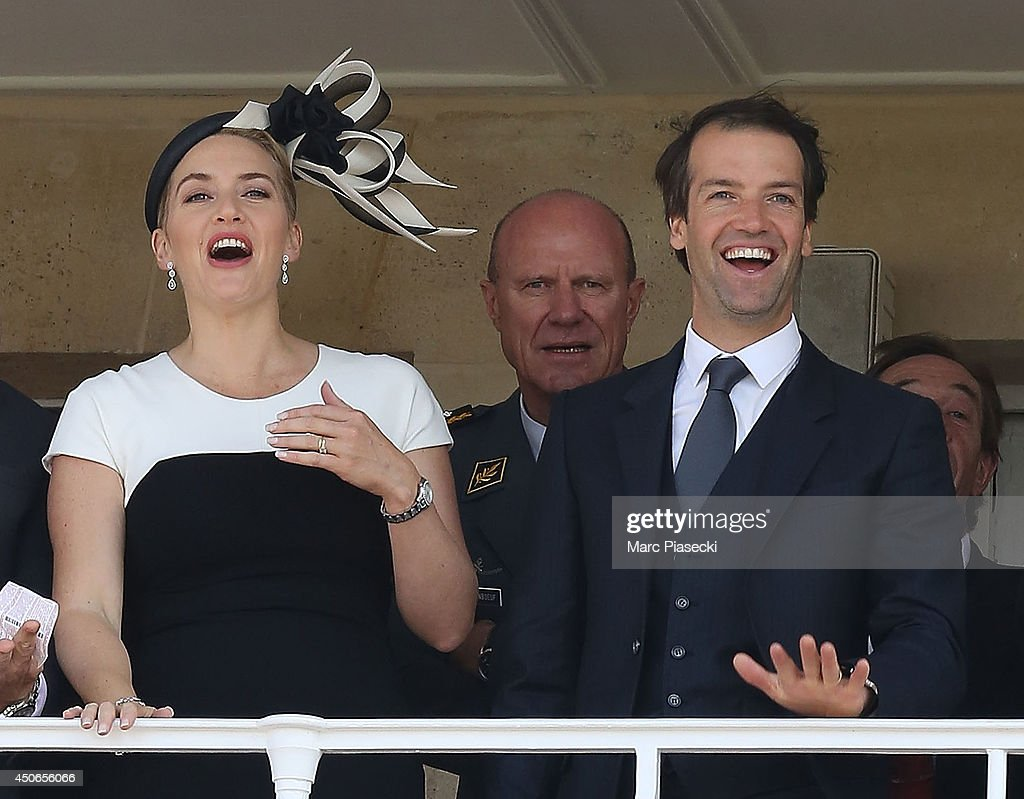 Actress Kate Winslet and husband Ned Rocknroll attend the 'Prix de Diane Longines 2014' at Hippodrome de Chantilly on June 15, 2014 in Chantilly, France.