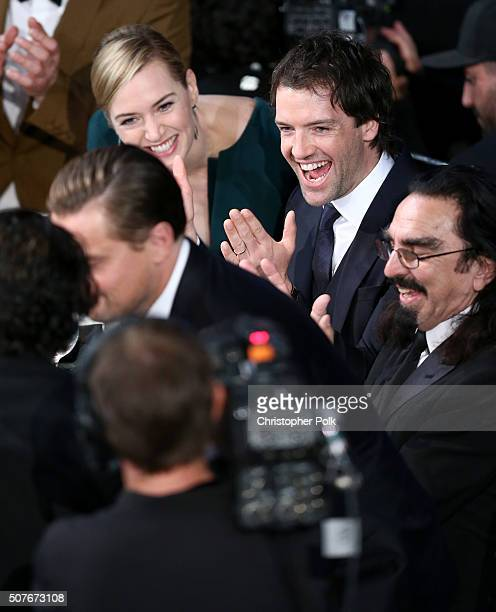Actress Kate Winslet and Ned Rocknroll cheer for Leonardo DiCaprio when he wins the award for Outstanding Performance by a Male Actor in a Leading...