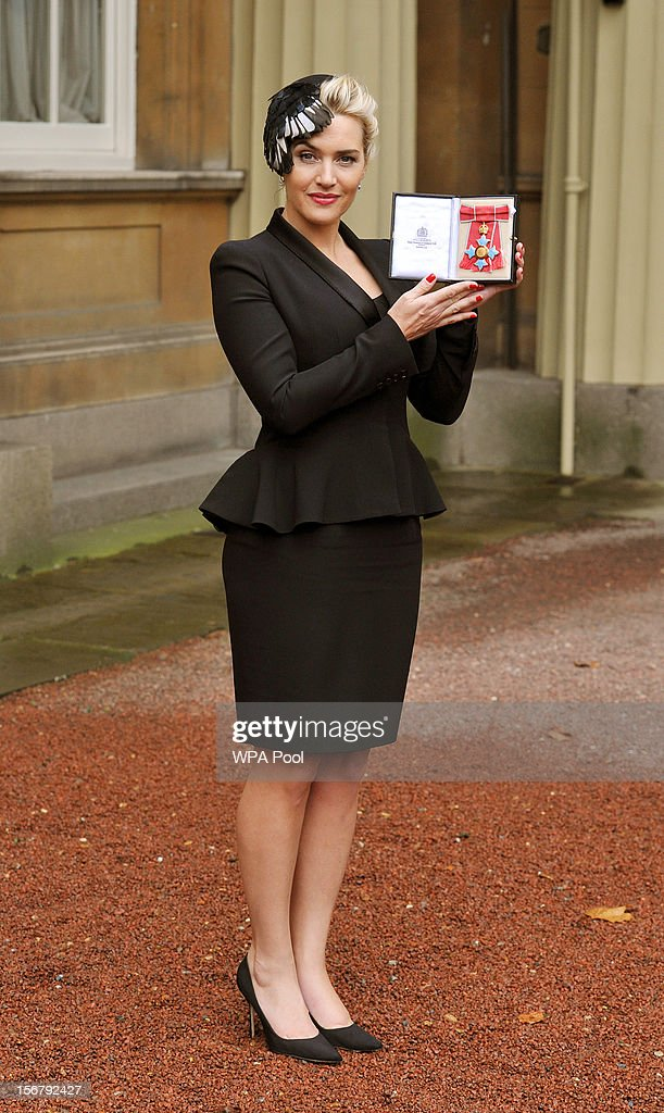 Actress Kate Winslet holds her CBE, for services to drama, which was awarded to her by Queen Elizabeth II during an Investiture ceremony at Buckingham Palace on November 21, 2012 in London, England.