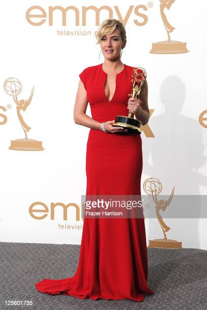 Actress Kate Winslet of 'Mildred Pierce' poses in the press room after winning Outstanding Lead Actress in a Miniseries or Movie during the 63rd...
