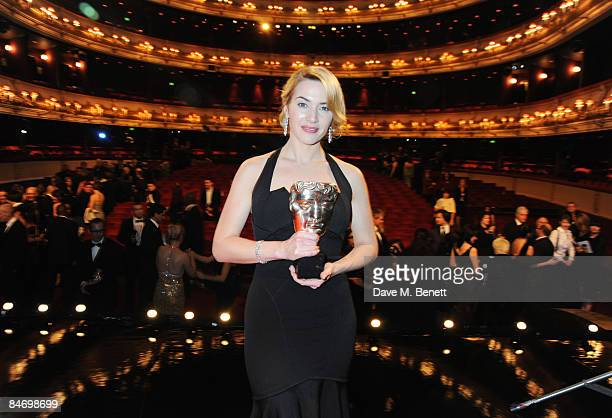 Actress Kate Winslet poses with the Best Actress Award for The Reader during The Orange British Academy Film Awards 2009 at the Royal Opera House on...