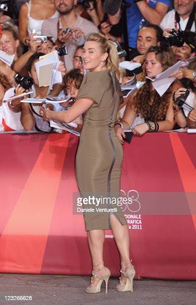 """Actress Kate Winslet signs autographs at the """"Carnage"""" premiere during the 68th Venice International Film Festival at Palazzo del Cinema on September..."""
