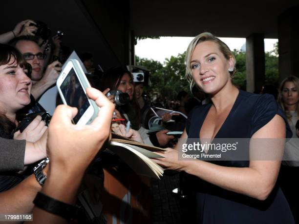 """Actress Kate Winslet signs autographs at the """"Labor Day"""" premiere during the 2013 Toronto International Film Festival at Ryerson Theatre on September..."""