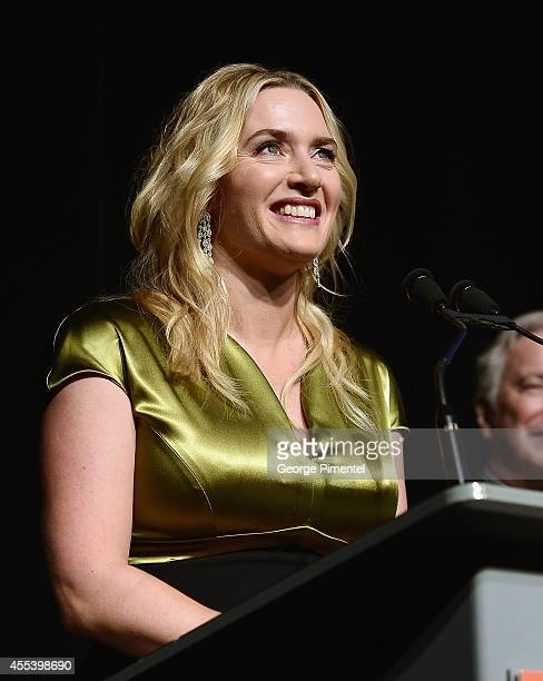 """Actress Kate Winslet speaks onstage at the """"A Little Chaos"""" premiere introduction during the 2014 Toronto International Film Festival at Roy Thomson..."""