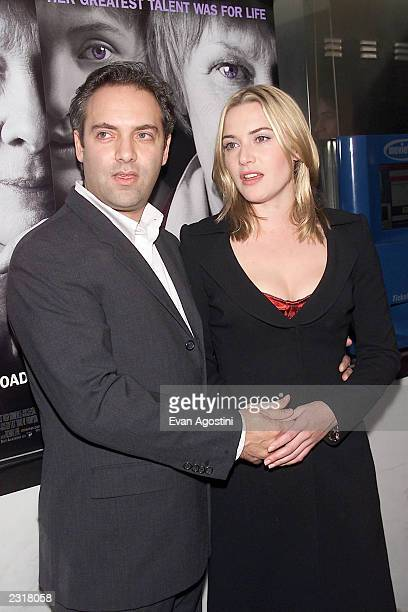 Actress Kate Winslet with boyfriend director Sam Mendes arriving at the world film premiere of Miramax's 'Iris' at the Paris Theatre in New York City...